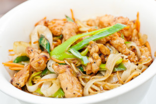 Teriyaki chicken with noodles and spring onions made in wok and